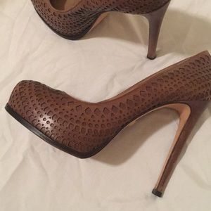 Perforated leather cutout platform heels.